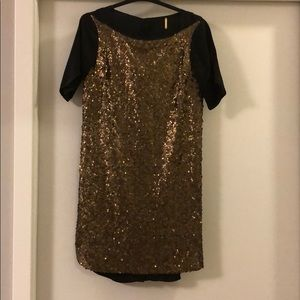 Black and gold sequin dress by Rebecca Minkoff